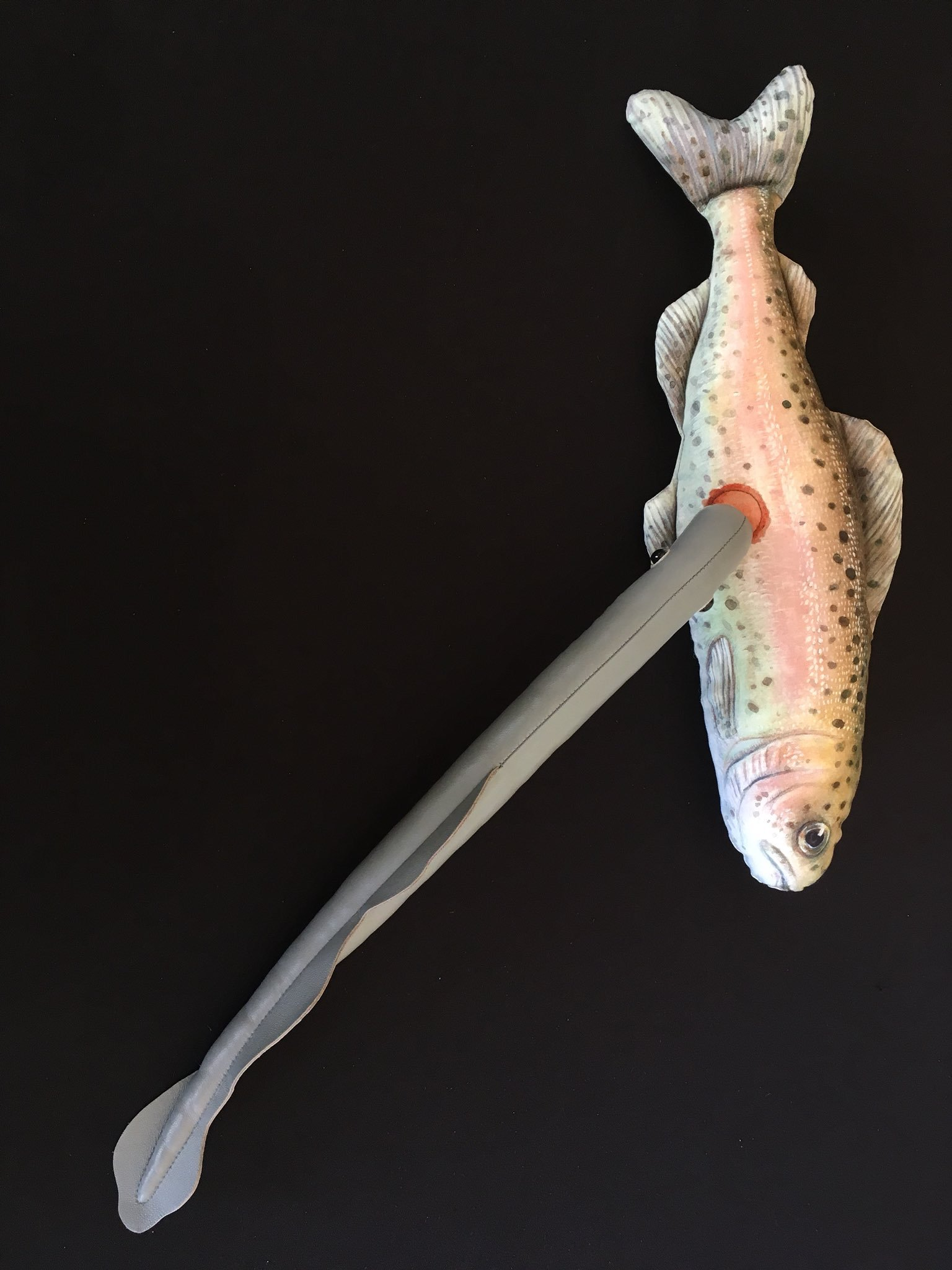 Plush fish with attached parasitic lamprey.